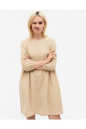 Monki Sol cotton check print mini smock dress in beige