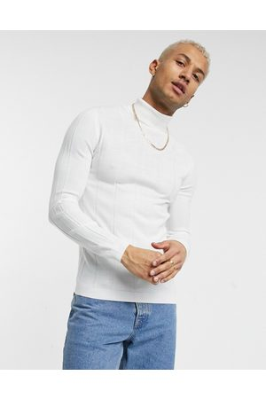 ASOS Knitted wide rib roll neck jumper in white