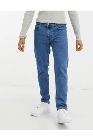 ASOS Stretch tapered jeans in retro mid wash blue