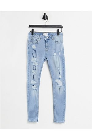 ASOS Women Stretch - Spray on 'vintage look' jeans with power stretch in light wash blue with heavy rips