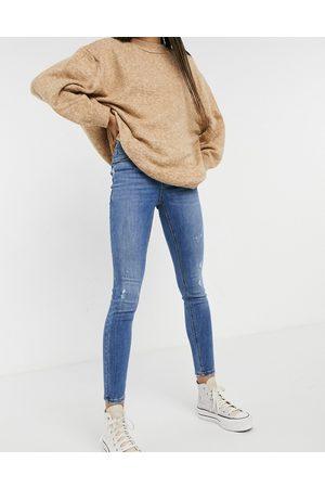 Vero Moda Sophia high-rise skinny jean with distressing in medium blue
