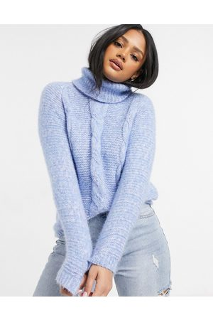 QED London Roll neck cable knit jumper in blue
