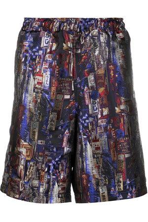 KOCHÉ All-over print panel shorts