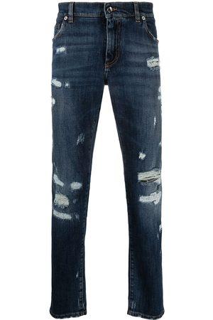 Dolce & Gabbana Men Slim - Embossed logo ripped slim-fit jeans