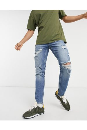 ASOS Stretch slim jeans in vintage mid wash blue with heavy rips
