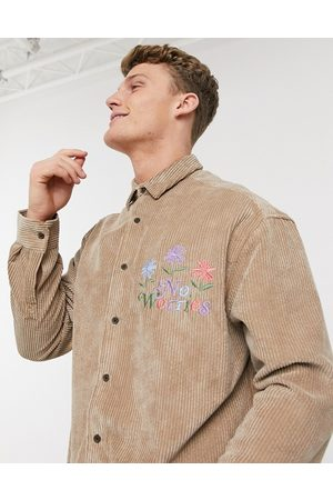 ASOS 90s oversized chunky cord shirt in tan with embroidery slogan-Beige
