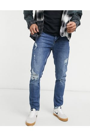 ASOS Slim jeans in dark wash with abrasions-Blue