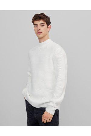 Bershka Cable knit turtleneck jumper in ecru-Beige
