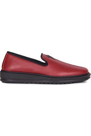 Giuseppe Zanotti Slip-on leather slippers with logo detail