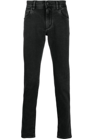 Dolce & Gabbana Logo embossed slim-fit jeans