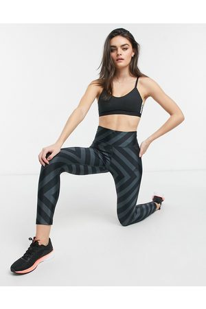 adidas All over graphic tights in black