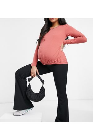 Mama Licious Mamalicious Maternity long sleeve t-shirt with knot front in dark rose-Pink