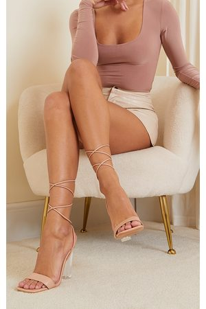 PrettyLittleThing Nude Pu Lace Up High Clear Block Heels