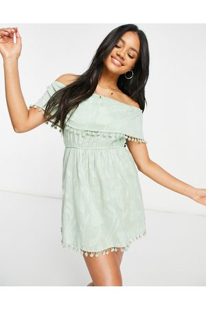 Influence Burnout bardot beach dress with pom poms in sage-Green