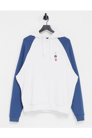 ASOS Oversized raglan hoodie in white with washed blue sleeves & chest line drawing