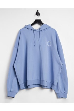 Weekend Collective ASOS curve oversized hoodie with in embroidery logo in washed blue