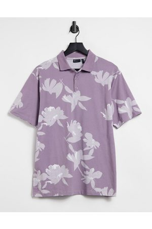 ASOS Relaxed short-sleeved polo shirt in purple with all-over floral print
