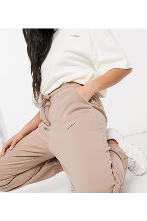COLLUSION Unisex joggers with logo print in brown