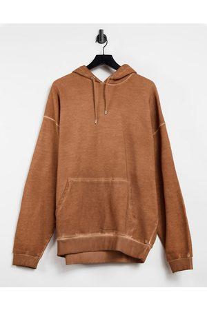 ASOS DESIGN Oversized hoodie in beige oil wash-Neutral