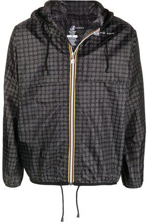10 CORSO COMO Raincoats - Graphic-print hooded raincoat