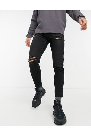 New Look Tapered jeans with rips in black