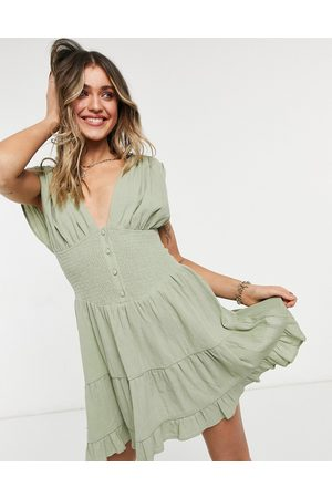ASOS Shirred waist button front tiered mini sundress in khaki crinkle-Green