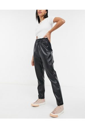 Pieces Leather look pants with elasticated waist in black