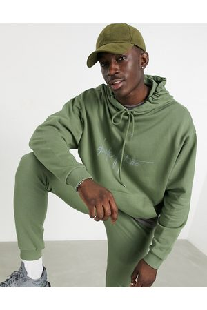 ASOS Co-ord oversized hoodie with logo chest print in olivine-Green