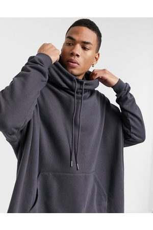 ASOS Extreme oversized funnel neck hoodie in washed black