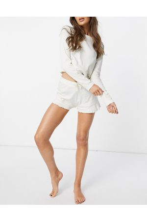 Threadbare Loungewear ribbed frilly long sleeved top and shorts set in cream