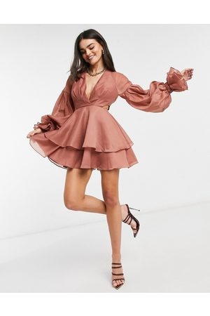 ASOS Pleated mini dress with blouson sleeve and cuff detail in -Pink