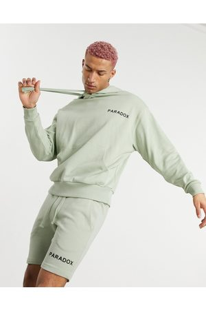 ASOS Co-ord oversized hoodie with small text print-Green