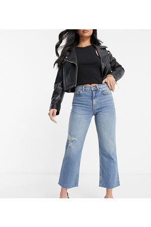 ASOS ASOS DESIGN Petite high rise stretch 'effortless' crop kick flare jeans in midwash with thigh rip-Blue