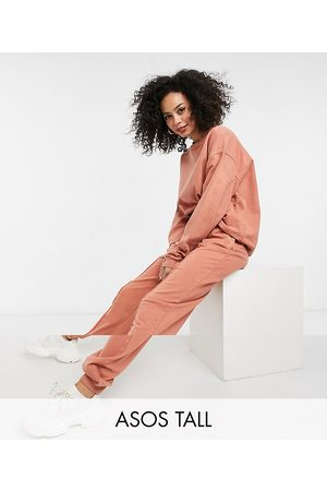 ASOS ASOS DESIGN Tall tracksuit oversized sweatshirt / oversized trackies with pintuck in acid wash in terracotta-Brown