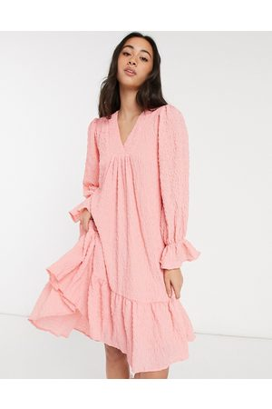 Y.A.S Textured mini smock dress with dipped hem and v-neck in pink