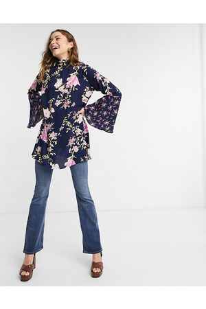 Free People Tate flared sleeve floral tunic in blue multi