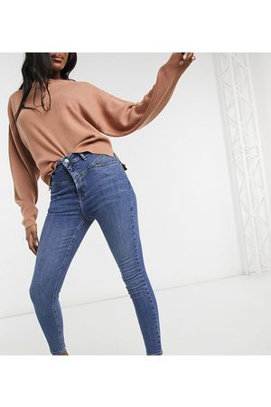 Reclaimed Vintage Inspired the '90 seam detail skinny jeans in mid blue wash