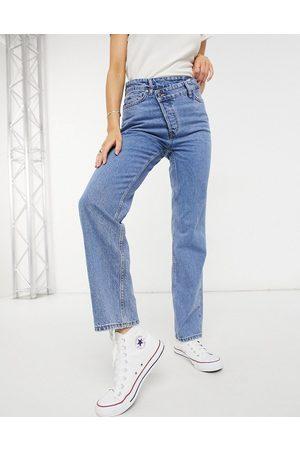 New Look Asymmetric button-detail straight leg jean in mid blue