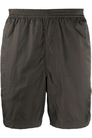TRUE TRIBE Neat Steve swim shorts