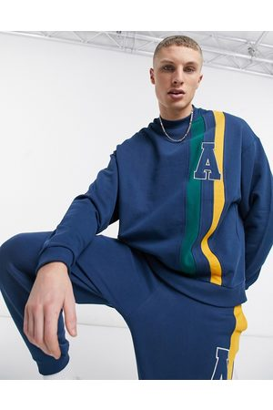 ASOS Co-ord oversized sweatshirt with cut and sew stripes in navy