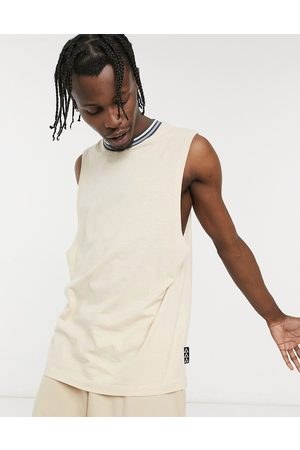 ASOS Relaxed singlet in beige with tipping and branded patch