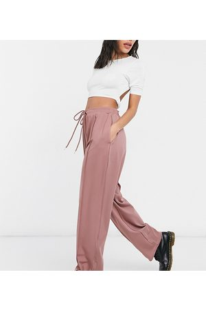COLLUSION Unisex relaxed trackies in polytricot in dusty pink co-ord