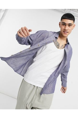ASOS DESIGN 90s oversized linen shirt with pockets in navy