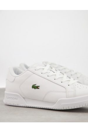 Lacoste Twin Serve cupsole plimsoll sneakers in white