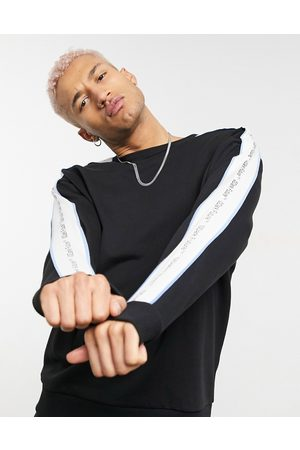 adidas Co-ord oversized sweatshirt in black with logo taping