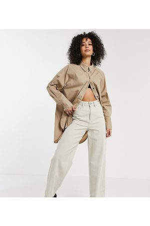 adidas Oversized longline shirt with dipped hem in beige-Tan