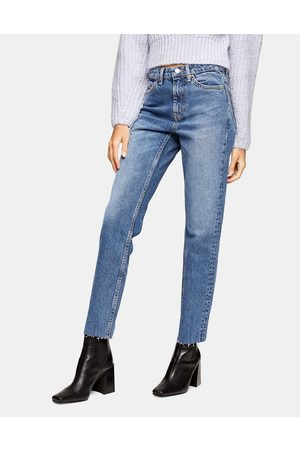 Topshop Ripped hem straight leg jeans in mid wash blue