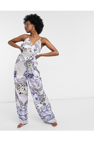 River Island Floral plunge beach jumpsuit in blue