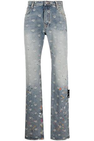 OFF-WHITE Logo-jacquard paint-splatter jeans