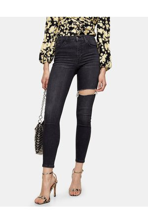 Topshop Jamie thigh rip skinny jeans in washed black